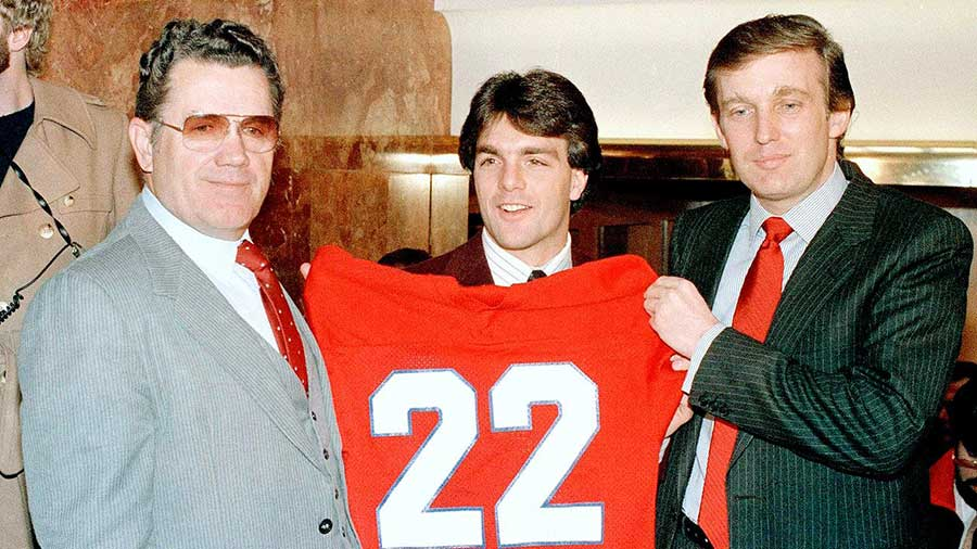 Boston College quarterback Doug Flutie poses with New Jersey Generals head coach Walt Michaels (left) and Generals owner Donald Trump at a news conference in New York on Feb. 5, 1985